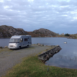 Silver Hymer parked by a loch