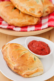 These cheesy and savory spinach ricotta calzones are so delicious and the perfect meatless meal!