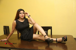 Tollywood Upcoming Actress Pooja Roshan Stills in Black Short Dress at Plus 1 Movie Trailer Launch  0372.JPG