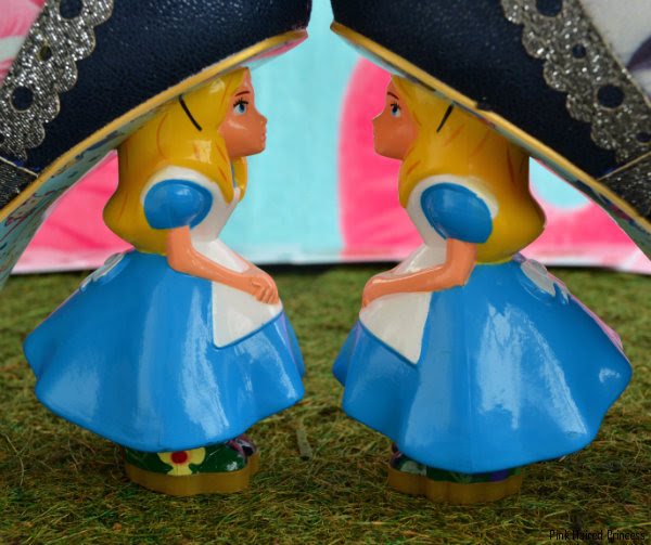 Disney Alice character heels facing each other