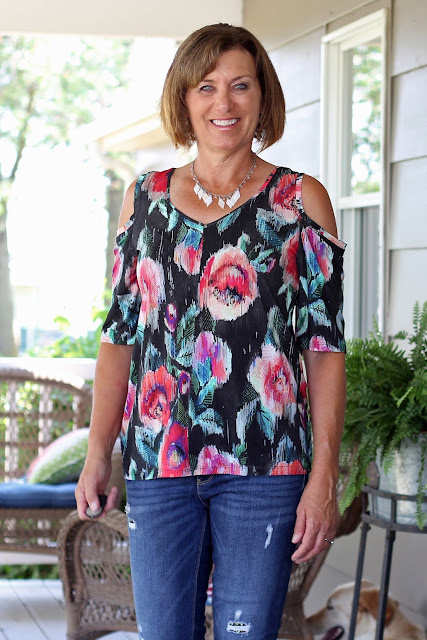 Simplicity 8337, view B, a cold shoulder look,  made from Mood Fabrics' floral jersey