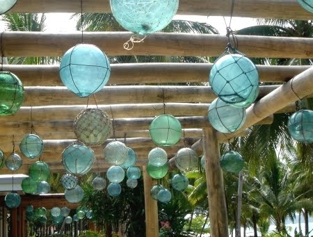glass floats hanging on porch