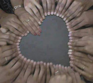 heart shape made by joining hands together