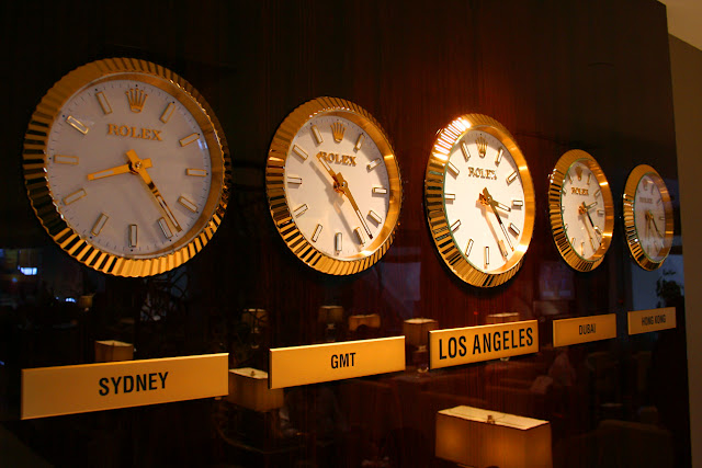 Clocks with times in various time zones at the Emirates Premium Lounge at LAX