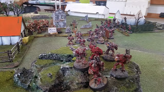 A photo of my Word Bearers havocs facing the imperial fists in a game of warhammer 40000