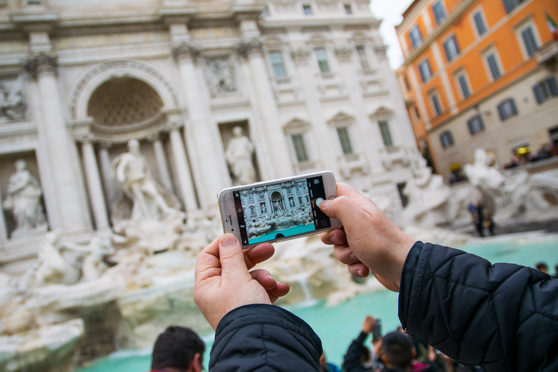Taking photos of the Trevi Fountain in Rome