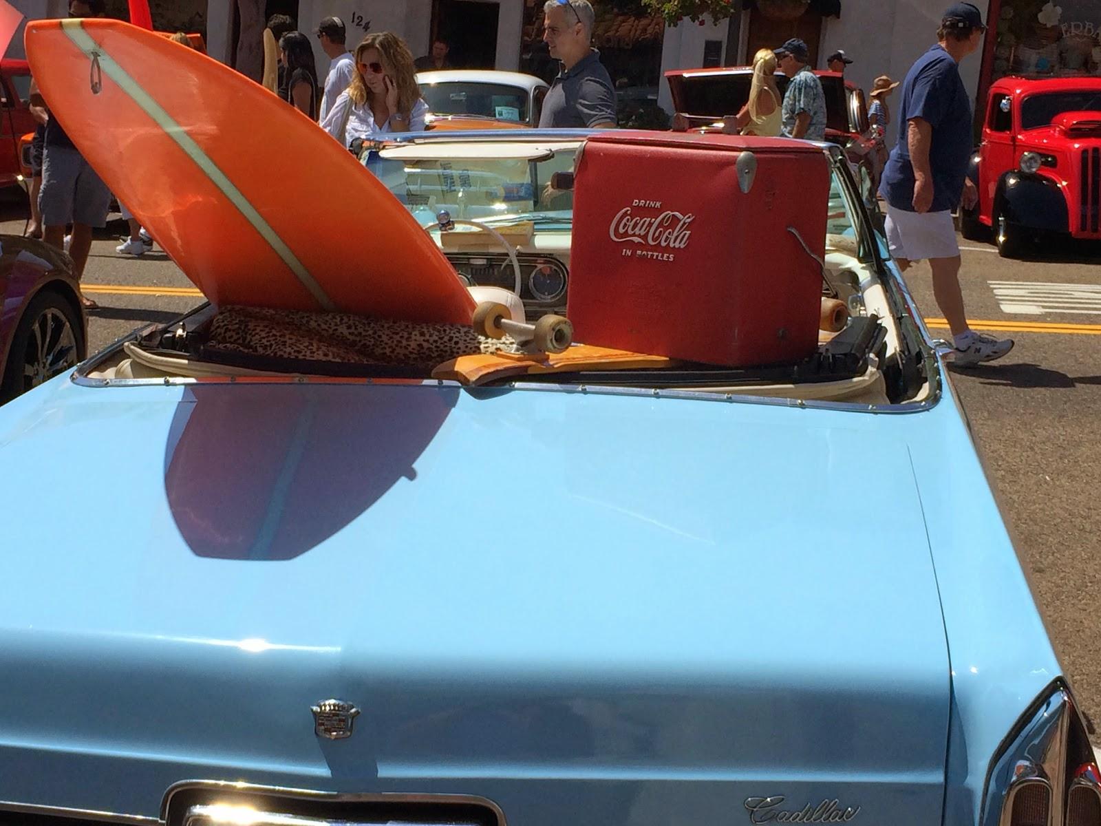 Cadillac convertible, longboard surfing, coca cola memorabilia