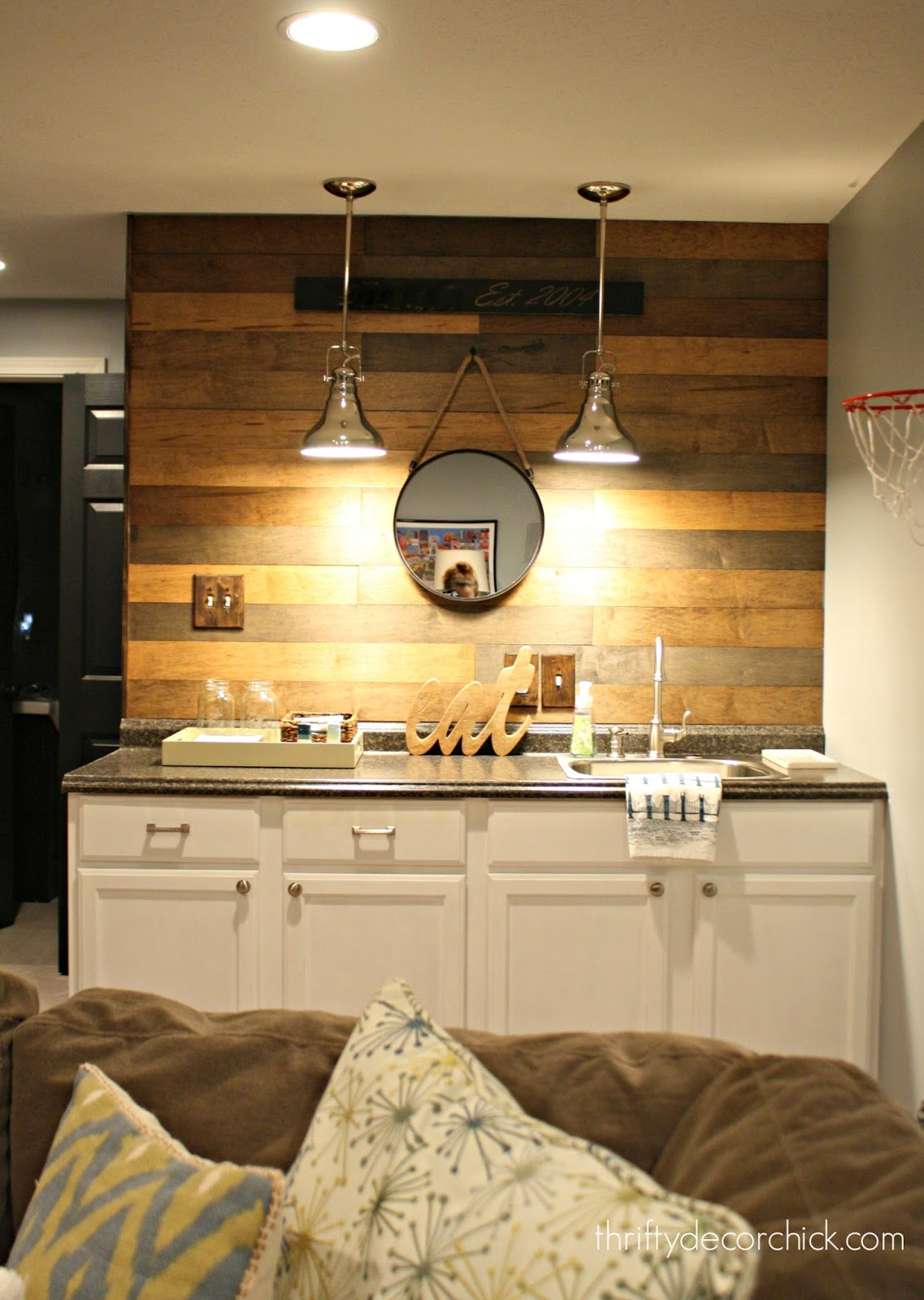 wood planked wall over kitchenette