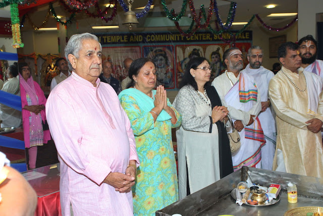 (L-r) Sunnyvale Hindu Temple president Balwant Birla, Rani Kumra, and Sudesh Birla seen with temple priests at the inaugural puja to launch the 25th anniversary celebrations. (Som Sharma photos)