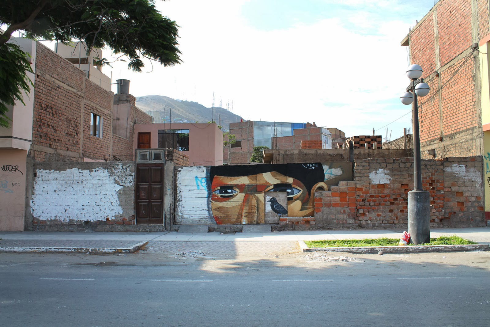 """""""The Host"""" a new street art piece by Peruvian artist JADE in the Chorillos district of Lima, Peru. 2"""
