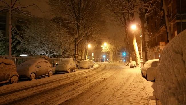 snow-coated cars in Paris