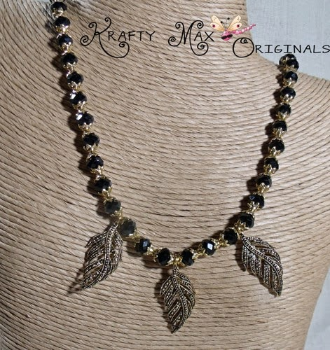 http://www.artfire.com/ext/shop/product_view/KraftyMax/7880045/black_and_gold_plated_leaves_are_creative_and_fun-3_piece_necklace_set/handmade/jewelry/sets/glass