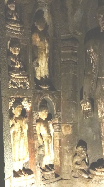 Some of the numerous Buddha images in Ajanta cave upper 6