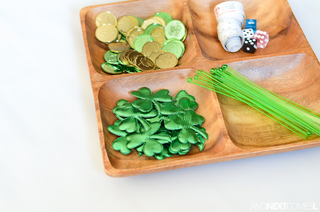 Simple math tray for St. Patrick's Day - perfect for toddlers and preschoolers to practice counting and measurement from And Next Comes L