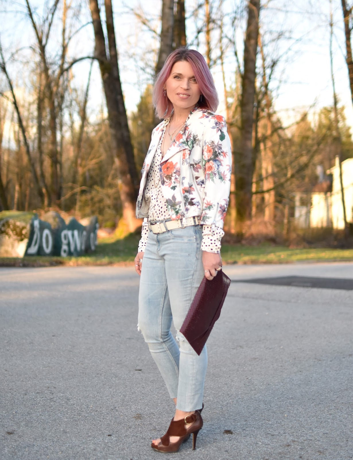 Monika Faulkner outfit inspiration - styling a dotted blouse with faded skinnies and a floral moto jacket