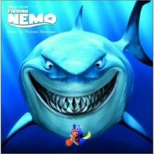grinning shark from DVD cover of Finding Nemo animatedfilmreviews.blogspot.com