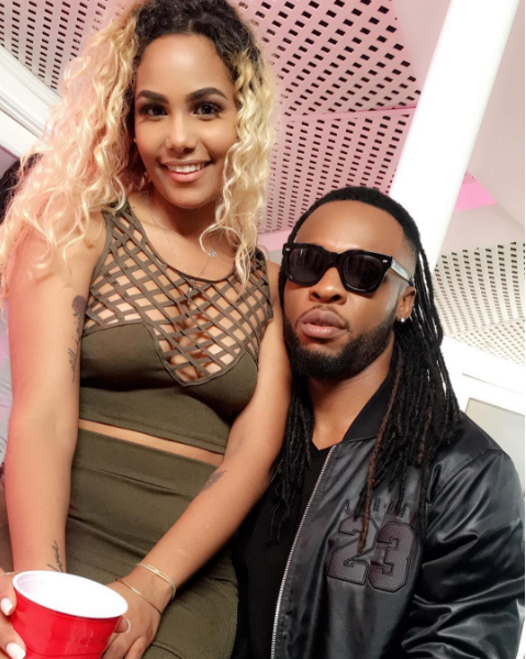 Flavour N'abania shares photos with a sexy lady sitting on