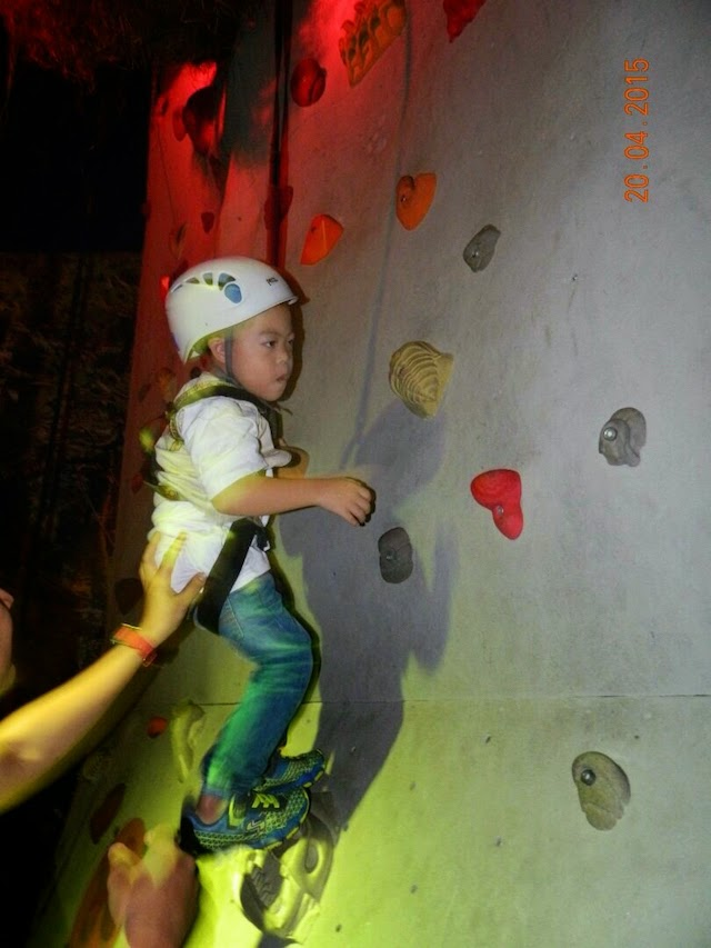 A child trying out the wall climbing activity to find the Pteranodon's eggs