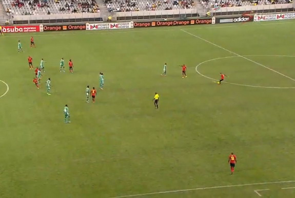 Mozambique player Dario Khan shoots a free-kick from 40 yards out to score a goal against Nigeria