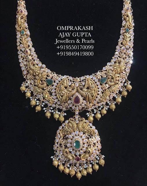 Grand Flat Diamond Sets by Omprakash Jewellers