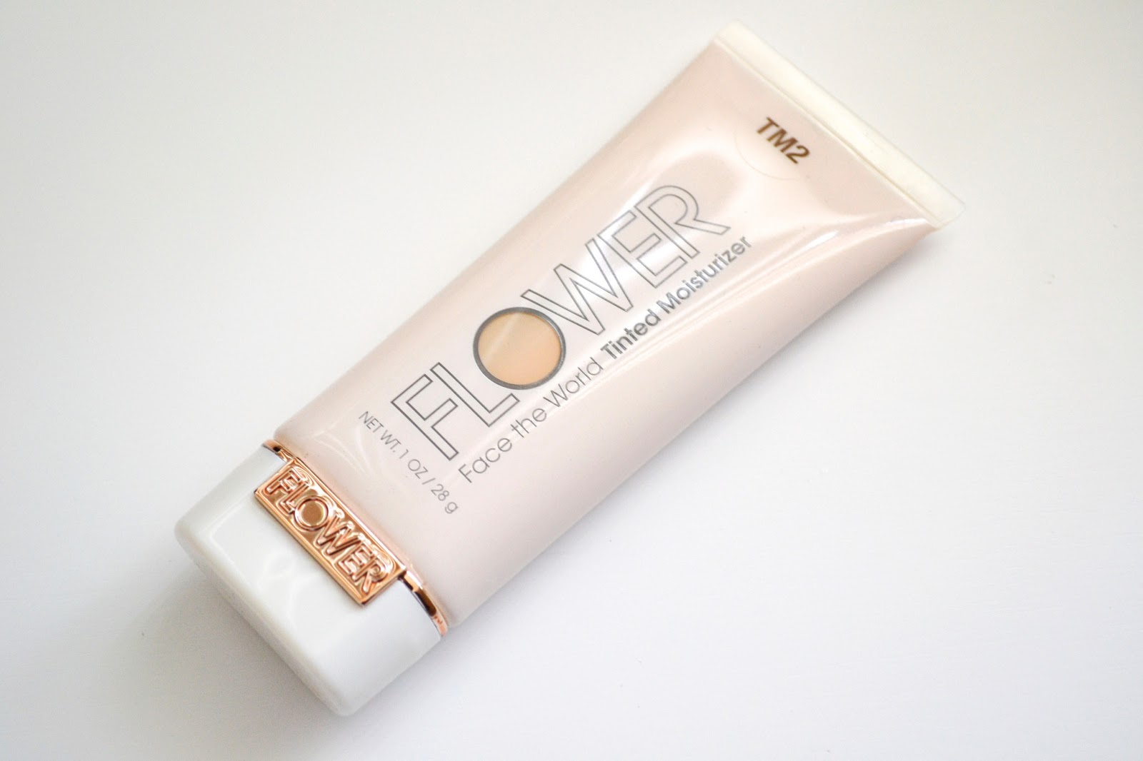 Aquaheart flower beauty face the world tinted moisturizer review may 1 2013 izmirmasajfo