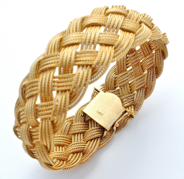 14k yellow gold braided bracelet can be found here
