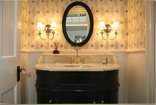 Elegant traditional decor in bathroom with black custom vanity and Farrow and Ball wallpaper