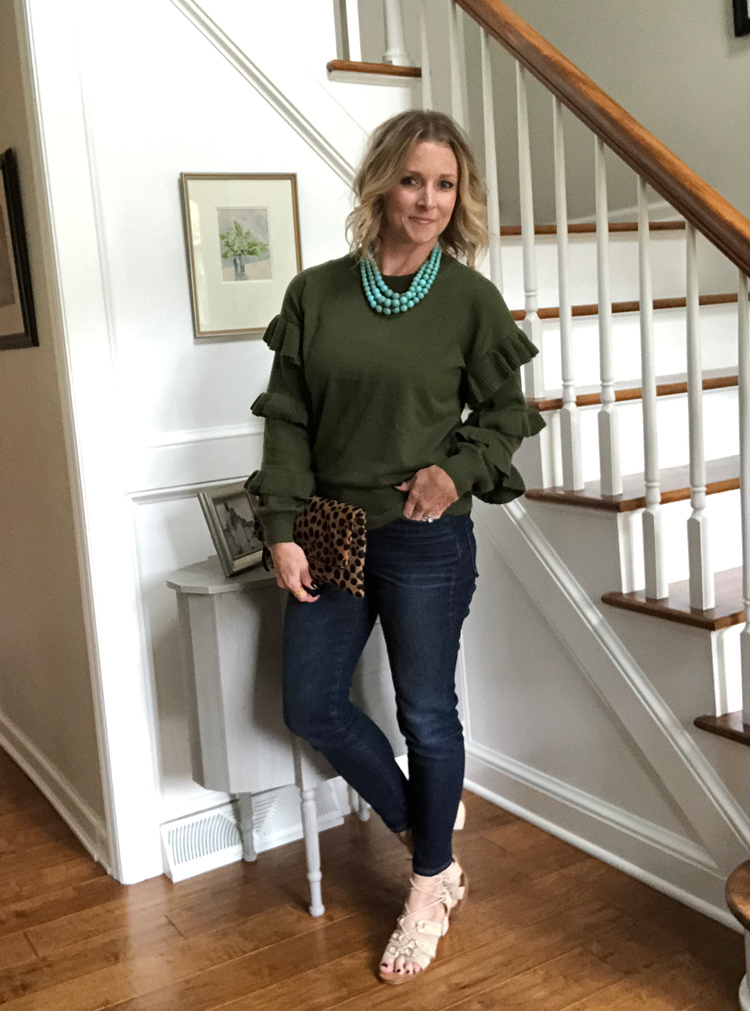 olive sweater with ruffles, skinny jeans and lace up sandals