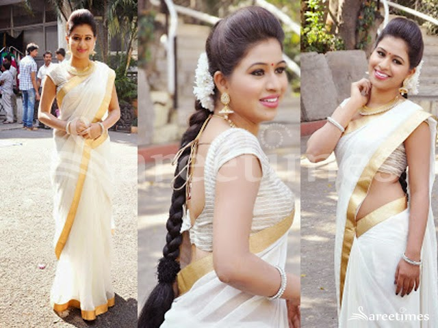 14e4a9809232ad Actress Manali Rathod at Silk Expo launch event in white saree with golden  border and short sleeved blouse with cross lines over the blouse with rope  ...