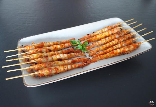 Langostinos a la plancha aderezados con una sabrosa y picante mermelada de chiles