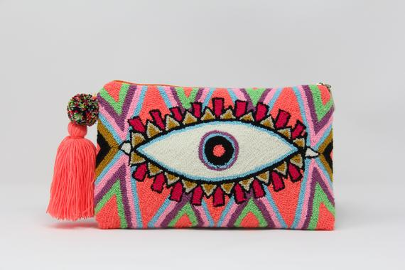 Bright peach, pink, purple and green punch needle clutch with evil eye design by A Mordel Sur Shop