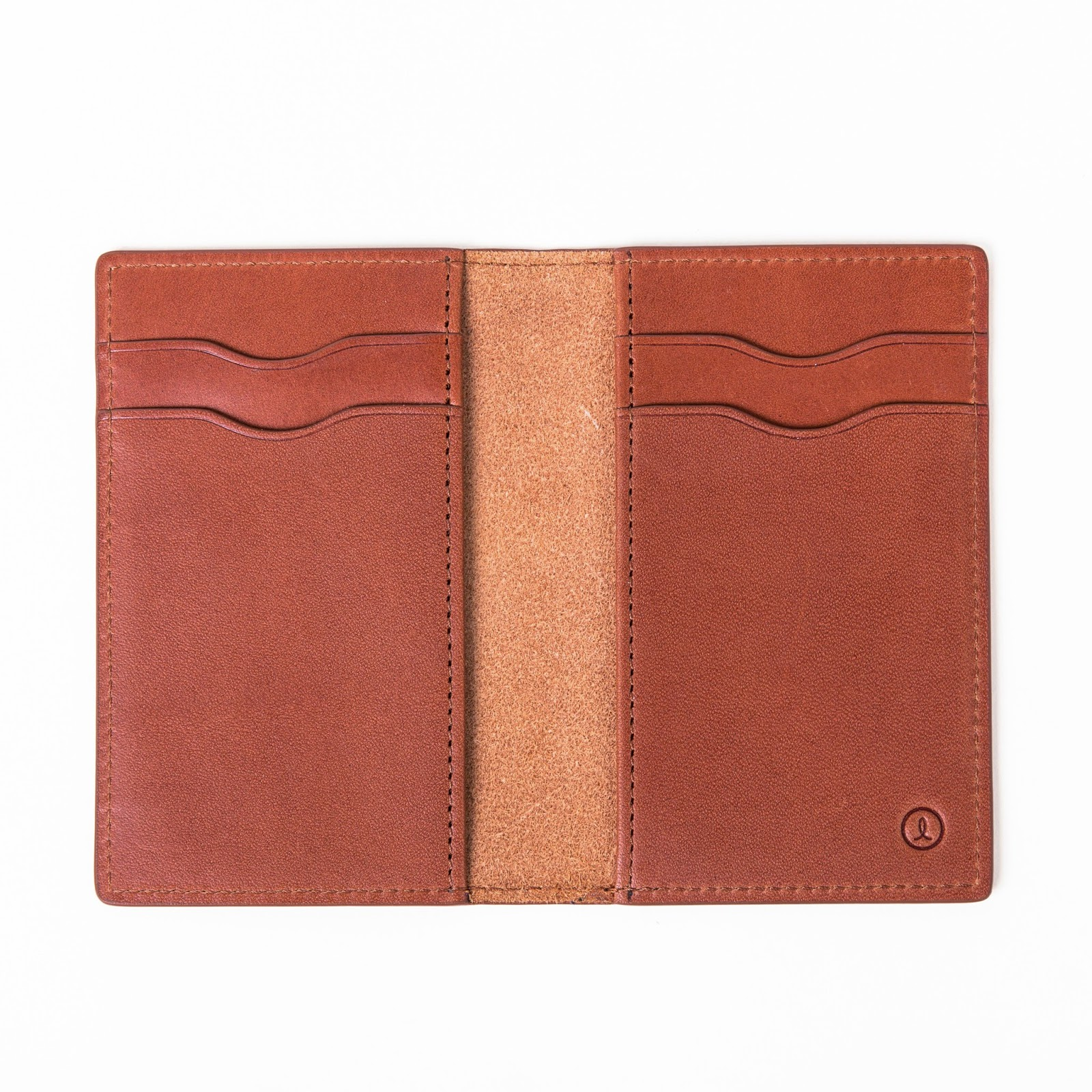 https://www.linjer.co/collections/men-small-leather-goods/products/vertical-wallet-cognac#details