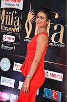 Meenakshi Dixit in Red One Shoulder Red Zipped up gown at IIFA Utsavam Award 07.JPG