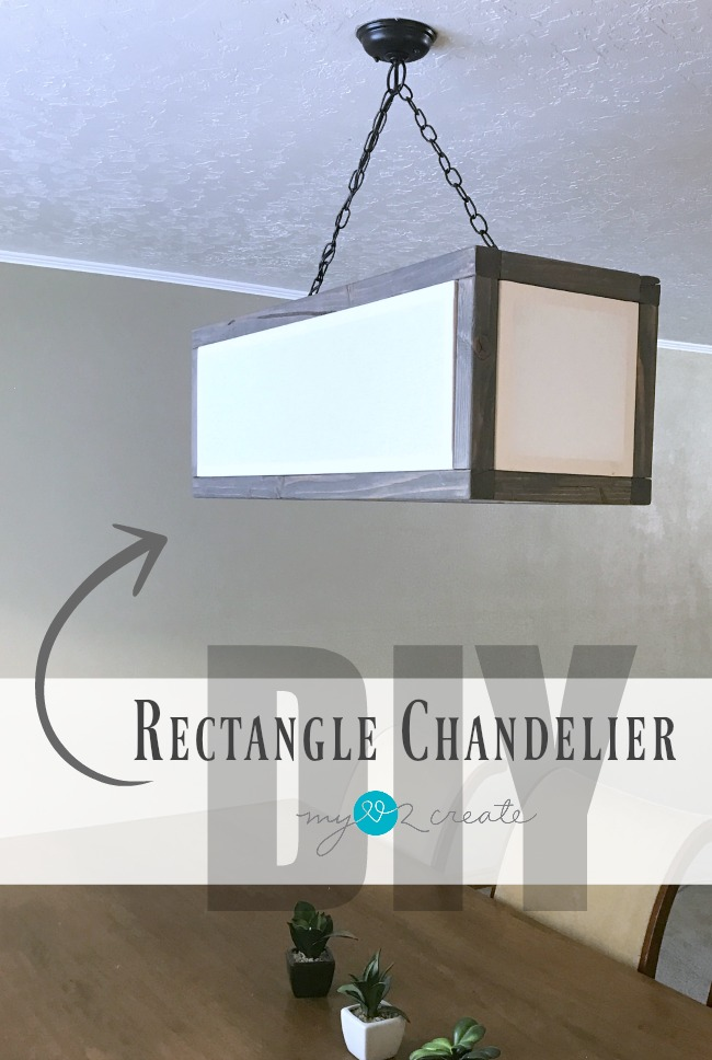 Build your own Rectangle Chandelier with linen inset shades to get that high end look for less.  Free plans and tutorial at MyLove2Create!