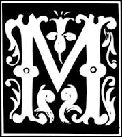 Huruf M