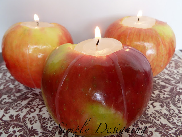 Apple Votives - perfect fall decor that is so simple to make!  This would be perfect for a Thanksgiving centerpiece tablscape or for fall mantle decor!  See full tutorial by clicking on image!  #diy #fall #falldecor #thanksgiving #thanksgivingdecor #tablescape #centerpieces #apples #votives #candles