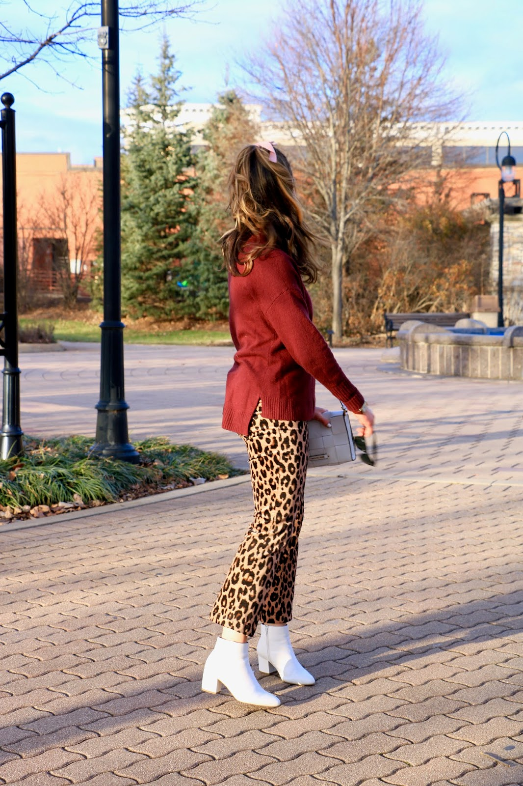Nyc fashion blogger Kathleen Harper showing how to wear leopard pants