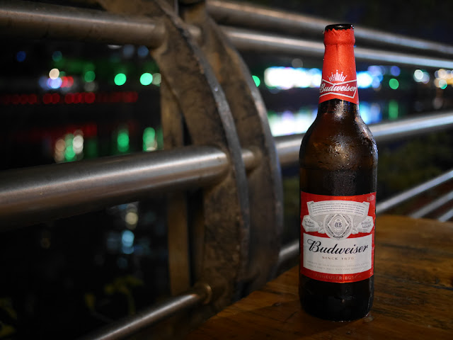 bottle of Budweiser Beer next to Jiangmen River