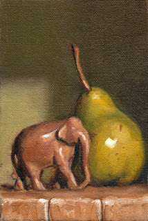 Oil painting of a small carved wooden elephant beside a green pear.