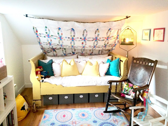 bright color nursery, antique bed, sleigh bed