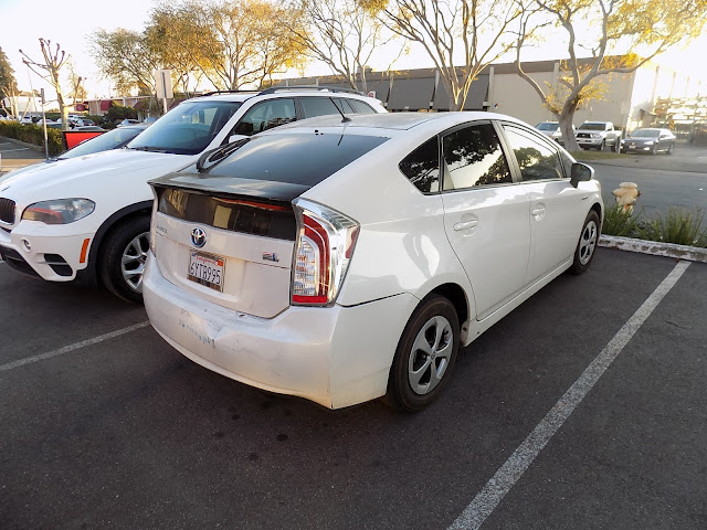 Prius rear bumper and tailgate damage before repairs at Almost Everything Auto Body.