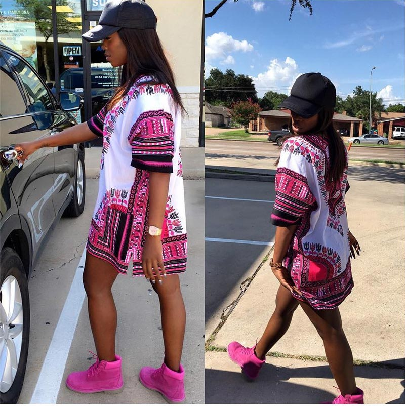 Tiwa Savage steps out in dashiki matched with pink Timberland boots in Texas