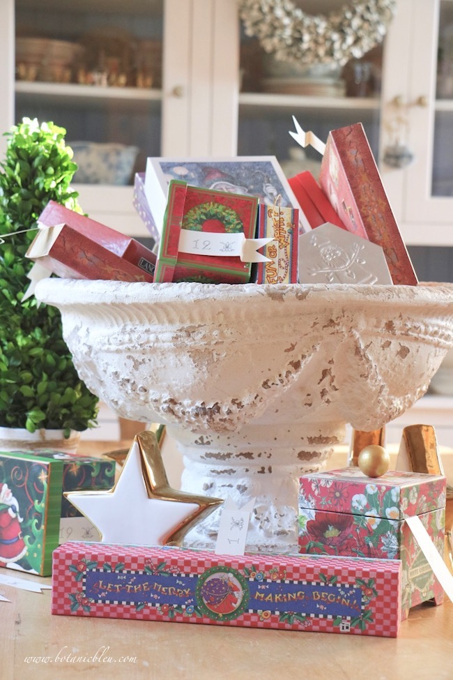 Display Advent calendar Christmas boxes in a French Country urn