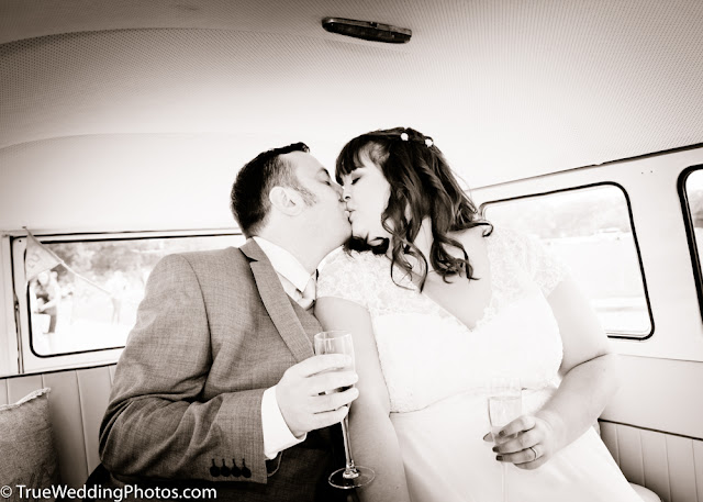 Bride and Groom kissing in VW Camper van
