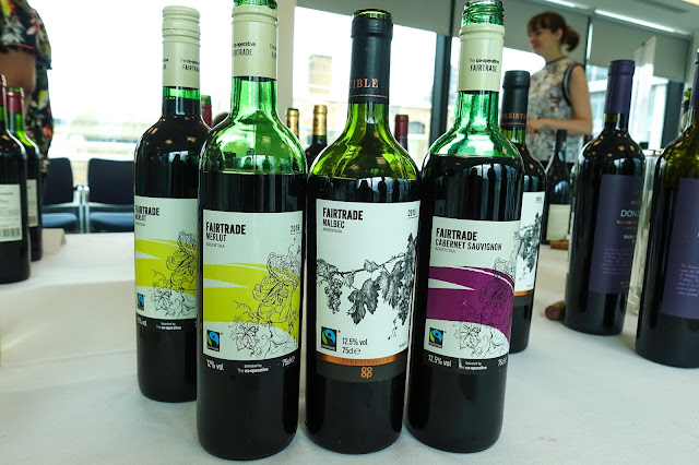 A  selection of 3 Fairtrade wines from Coop including a bottle of Merlot, Malbec and Cabernet Sauvignon