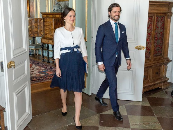 Princess Sofia Hellqvist of Sweden wore Seraphine maternity Dress and Coat