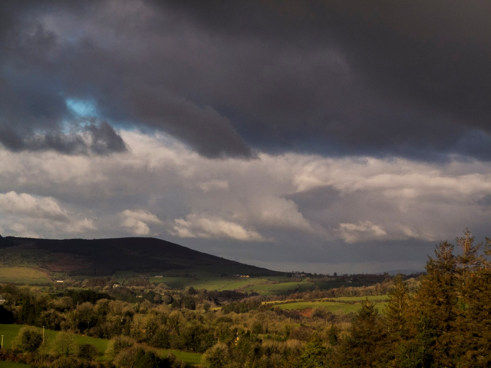 Dark clouds over the Boggeragh Mountain valley.