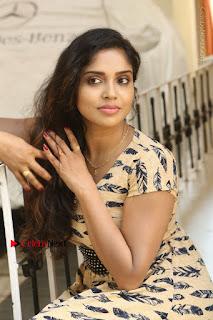 Telugu Actress Karunya Chowdary Stills in Short Dress at ATM Not Working Press Meet  0181.jpg