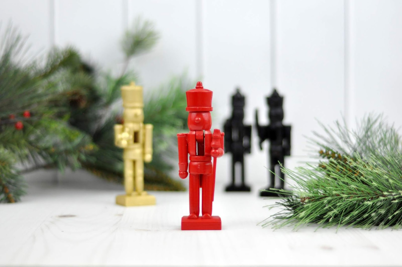 Spray Painted Nutcracker DIY Craft by Jen Gallacher for www.jengallacher.com. #christmascraft #spraypaint #nutcracker #jengallacher