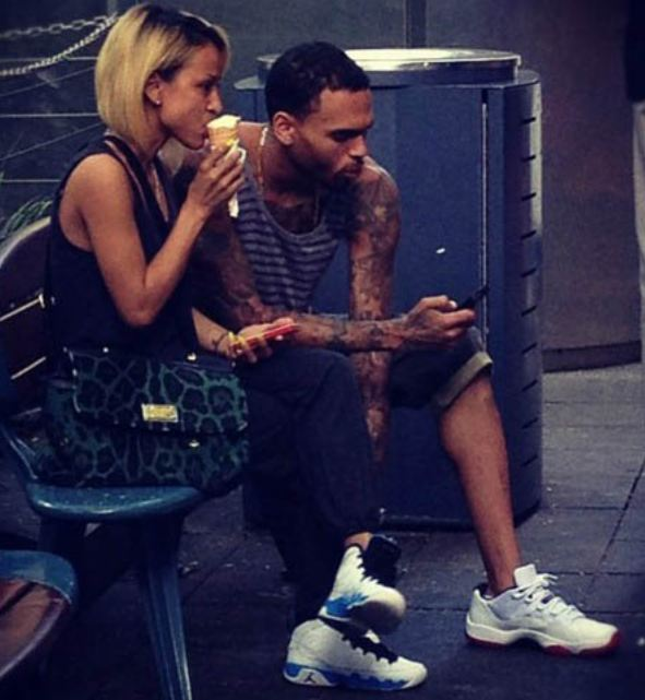 38012212912 Check out Chris Brown & his gurl Karrueche chilling out with some ice cream  Rockin Air Jordan 11 Low's & University Blue 9 Sneakers.